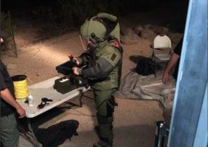 Pueblo Bomb Squad investigates suspicious device at scrap yard.