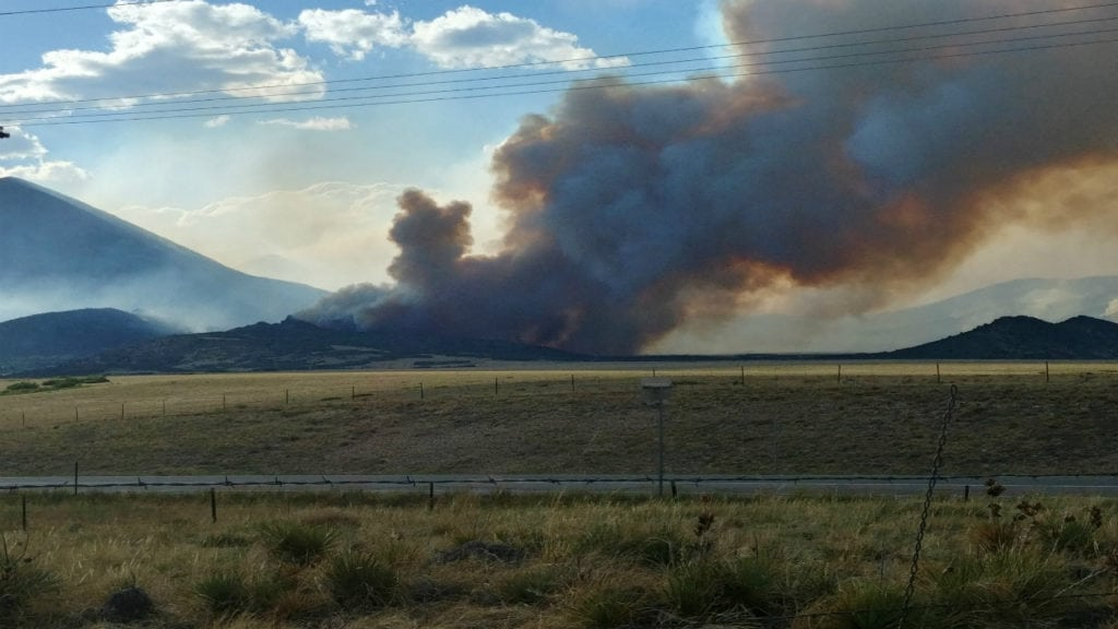 A massive plume burns near Silver Mountain as part of the Spring Fire on July 2, 2018.