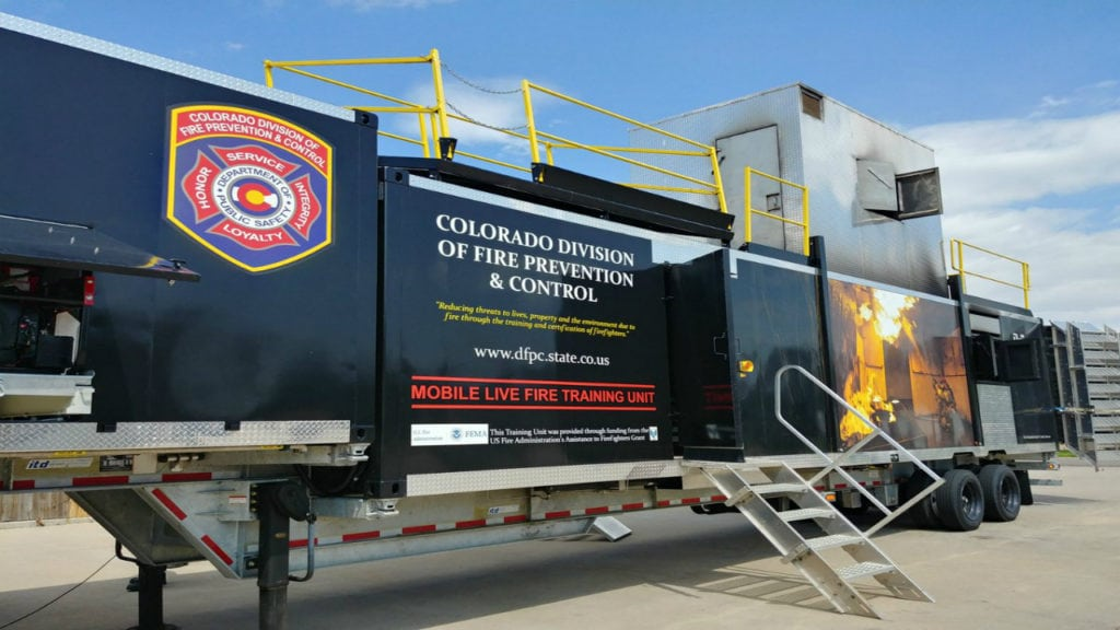 The Colorado Division of Fire Prevention and Control's Mobile Live Fire Training Unit is set up for training at the Canon City Area Fire Protection District Station One on August 22, 2018.