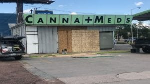 Canna Meds marijuana dispensary is undergoing repairs after SUV plowed through glass wall.