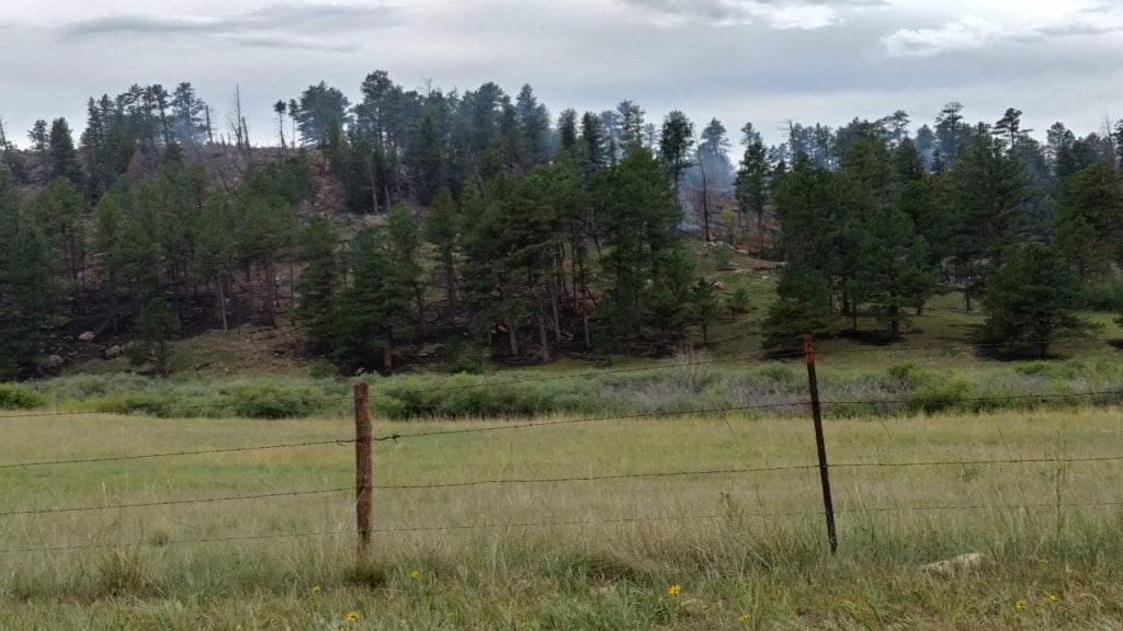 The Rainbow Fire, burning 10 miles north of Woodland Park, continues to smolder on Aug. 30, 2018, more than three weeks after it ignited.