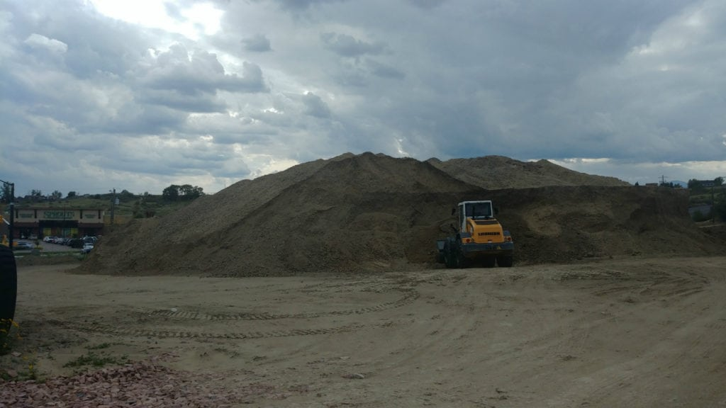 A mound of dirt stands where construction will soon begin on the Plaza at Barnes West, a new development to include a hotel, gas station and other retail shops near the intersection of Powers and Barnes in Colorado Springs.