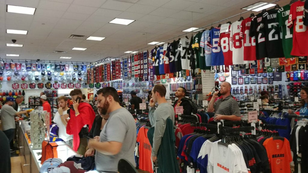 Shoppers check out Nike gear inside Prime Time Sports after the store owner announced a 50 percent-off sale on the gear following Nike's ad campaign with former NFL quarterback Colin Kaepernick.