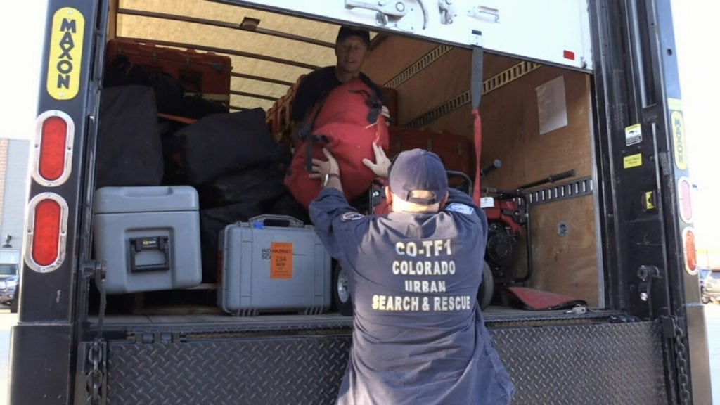 Members of Colorado Task Force 1 pack their equipment into trucks ahead of a Sept. 11, 2018, deployment to help with disaster recovery and relief ahead of Hurricane Florence.