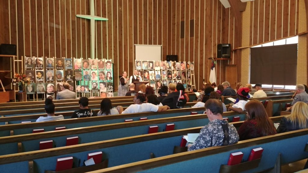 Families and friends of murder victims attend a National Day of Remembrance event at Life Church in Colorado Springs on Sept. 25, 2018. The event was organized by Mothers of Murdered Youth (MOMY), which helps the families of murder victims.