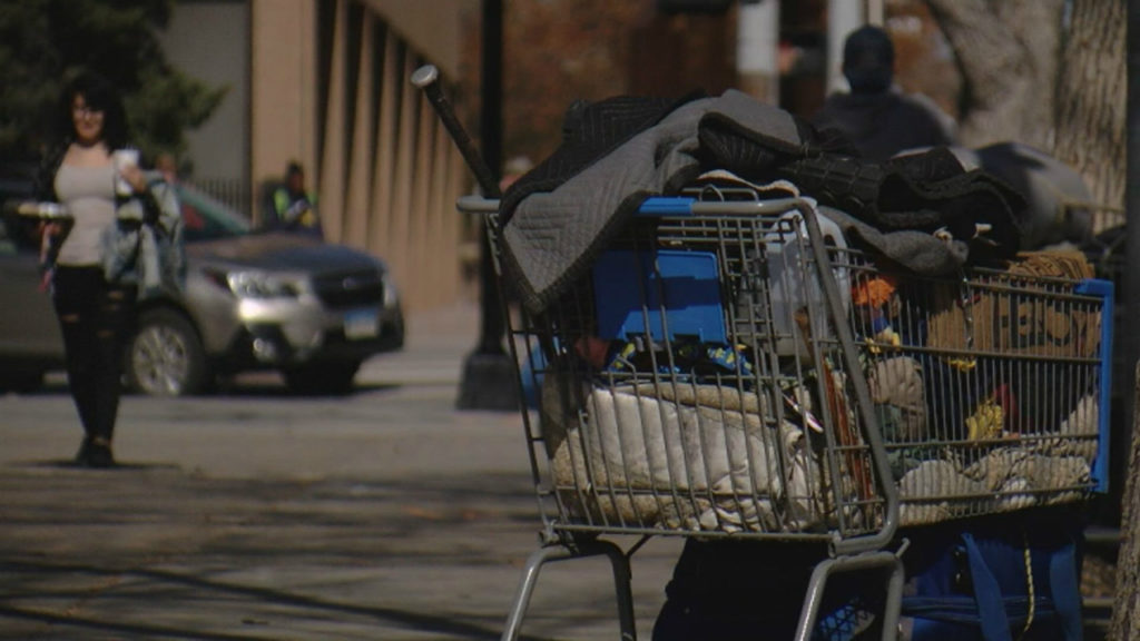 A homeless person's cart of belongings on a sidewalk in downtown Colorado Springs. The city is looking for feedback on a draft report that includes eight goals for helping the homeless community.
