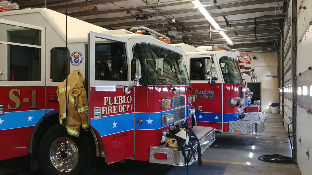 Engines sit inside Pueblo Fire Station 1.