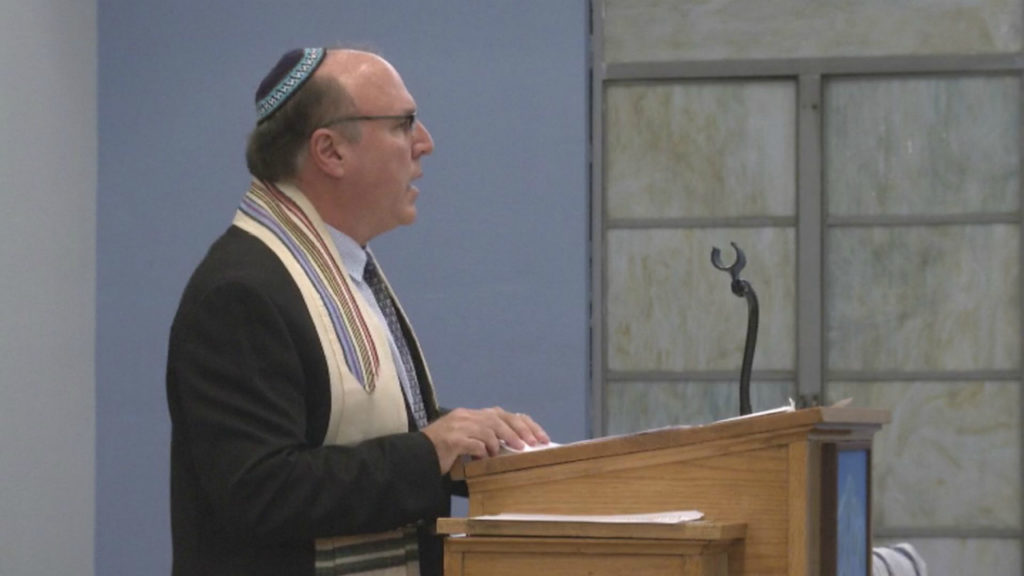 Rabbi Steven Kaye reads remarks before the congregation gathered at Temple Beit Torah on Nov. 9, 2018. Kaye also works with the American Red Cross, just returning from a deployment to Pittsburgh to help the Jewish community following the Tree of Life Synagogue shooting on Oct. 27.