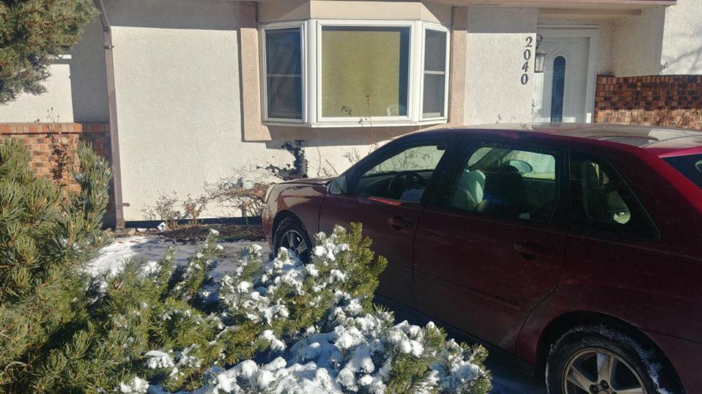 Car hits house