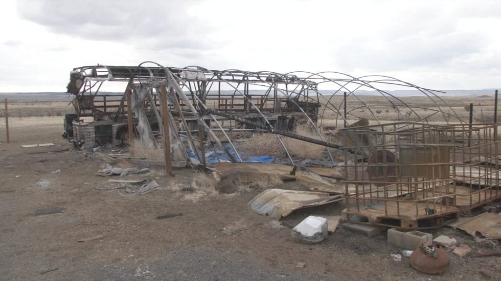A property owner in the Midway area lost a bus, garage, hoop house, camper, storage unit and lumber during the Carson Midway Fire. More than a year later, he's still waiting on financial assistance from Fort Carson, who admitted to starting the fire.