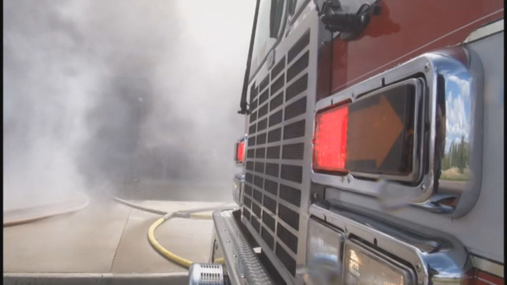 A Colorado Springs Fire Department engine provides water for firefighters during a training exercise.