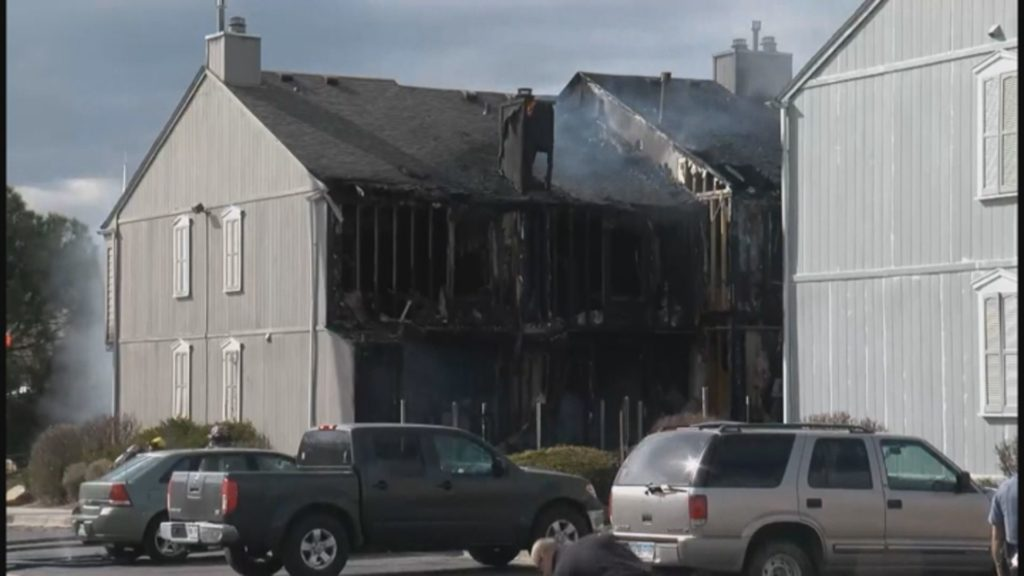 Firefighters battle a fire at the Sunstone Townhomes in March 2018. The fire destroyed 20 units.