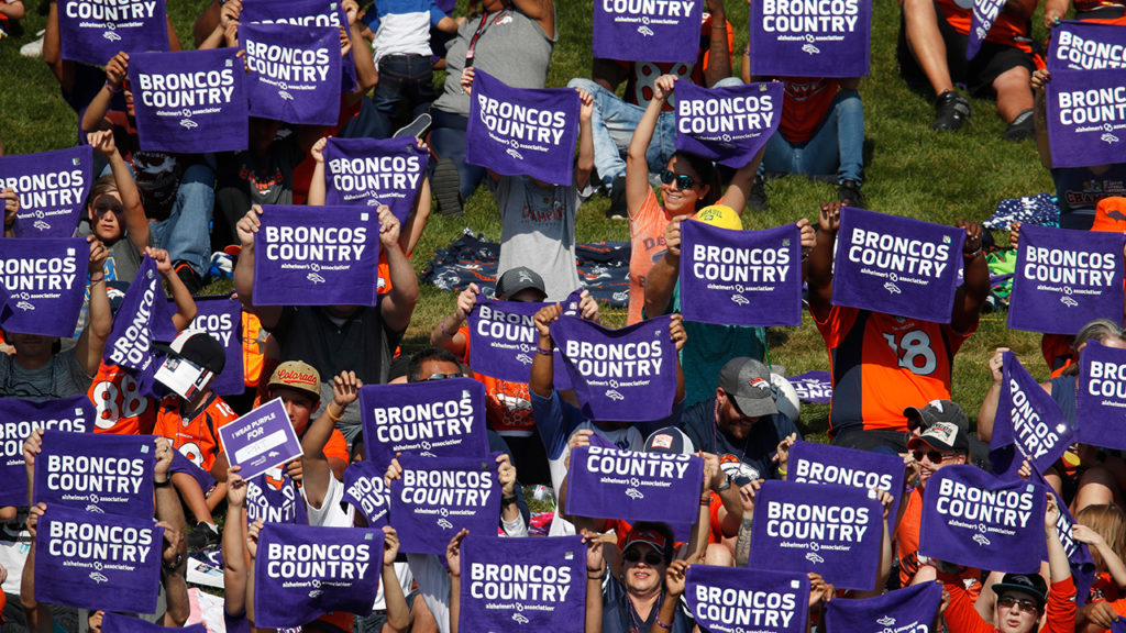 Purple towels Broncos fans